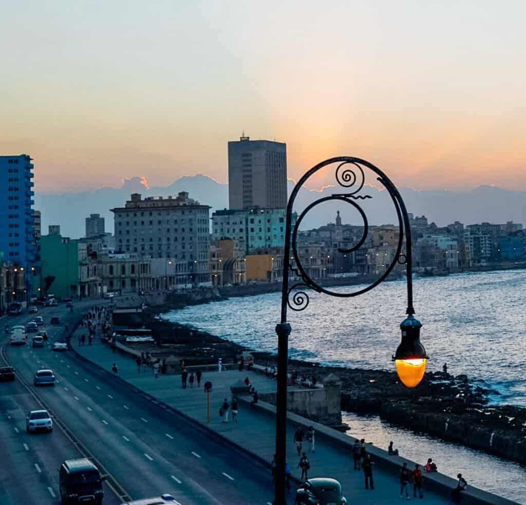 Havana Malecon during Sunset - view from above showing the oceanfront seawall, buildings and cars