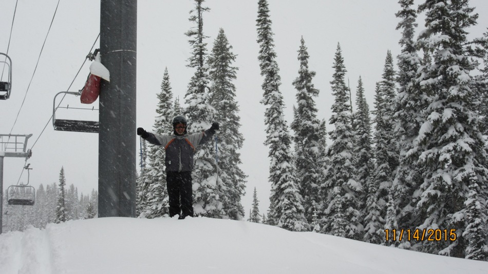 An excited Greg with powder up to his knees