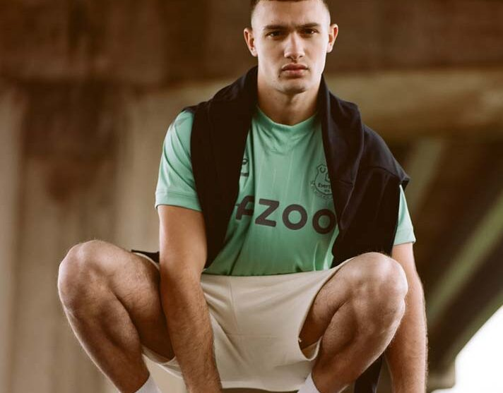 Mint green jersey with black jacket