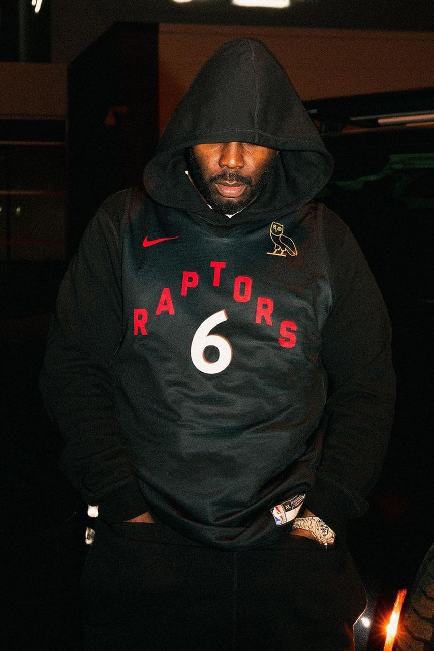Black jersey with red letters on player