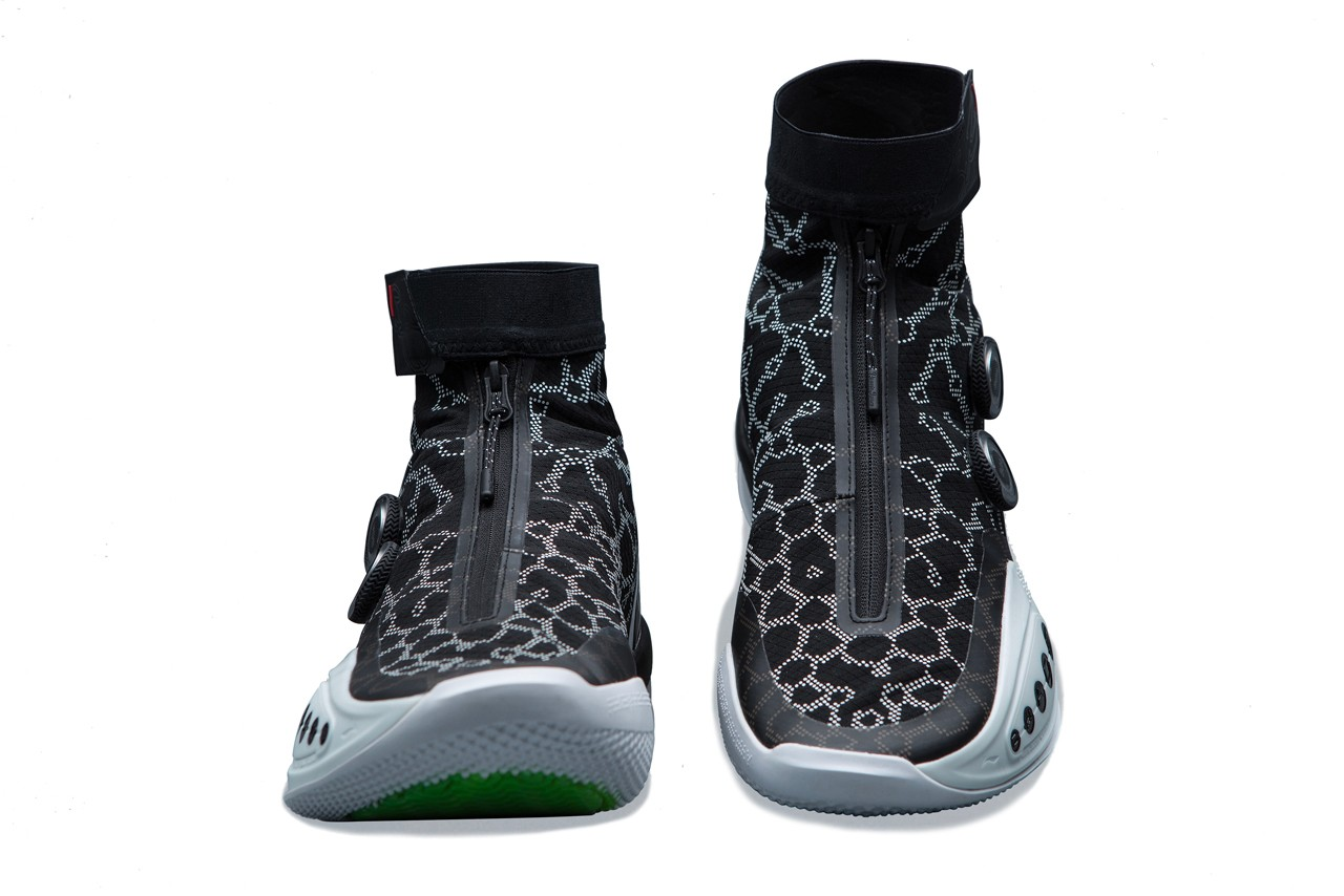 Black sneakers with green soles