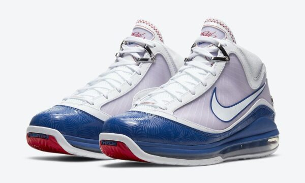 Two sneakers with red sole, blue bottom portion and top white foot