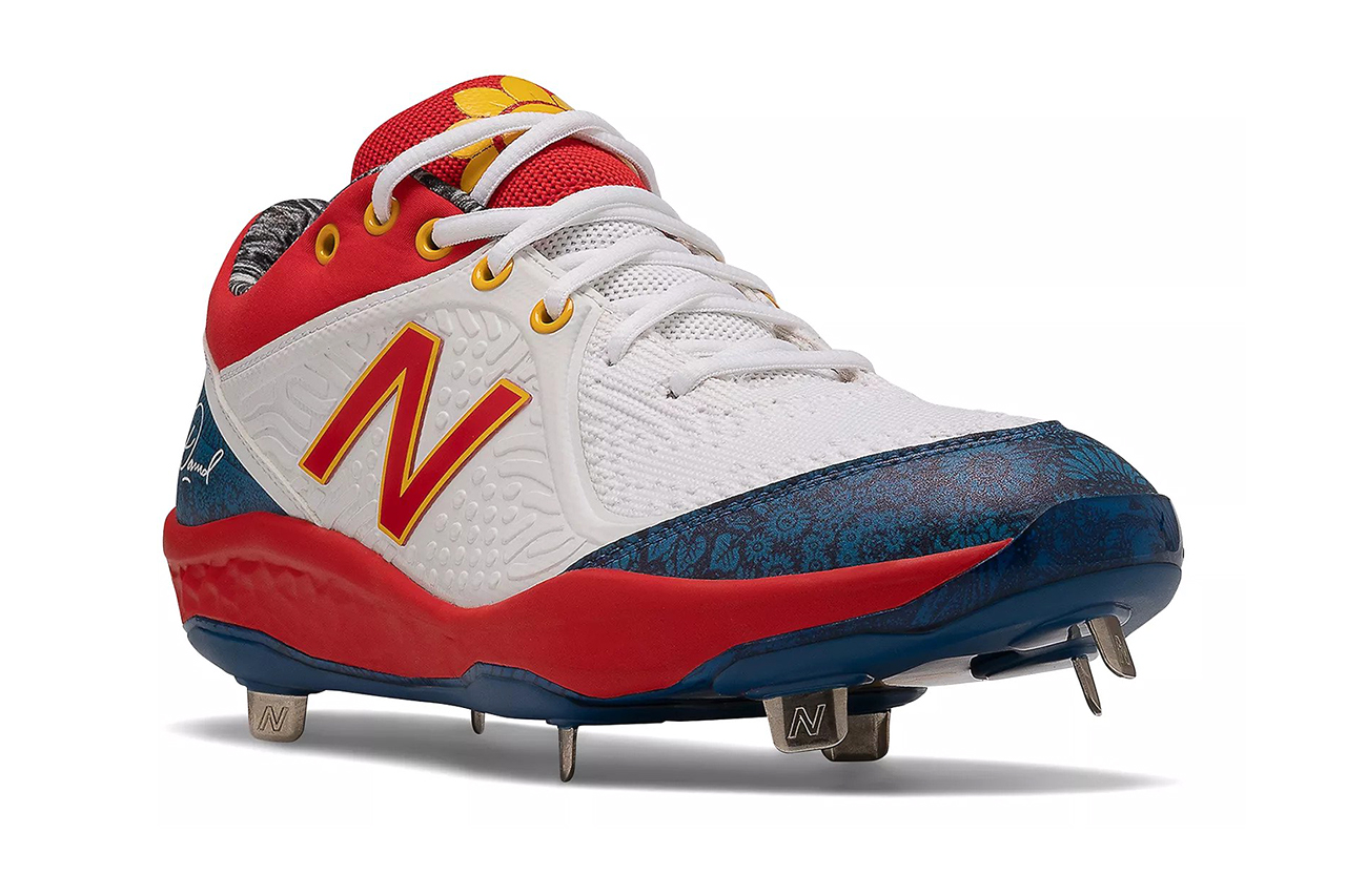 White sneaker with cleats on the bottom