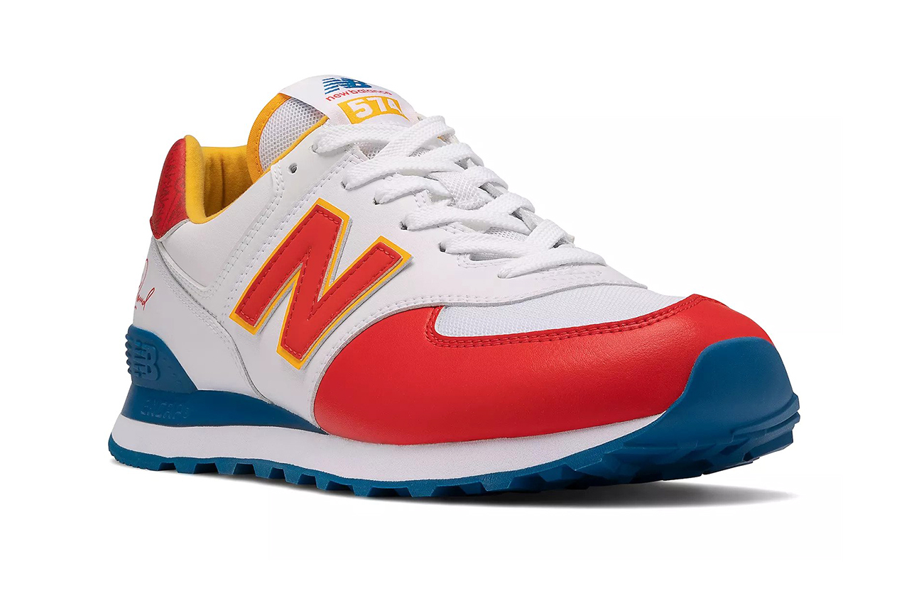 White sneaker with red toe and blue heel.