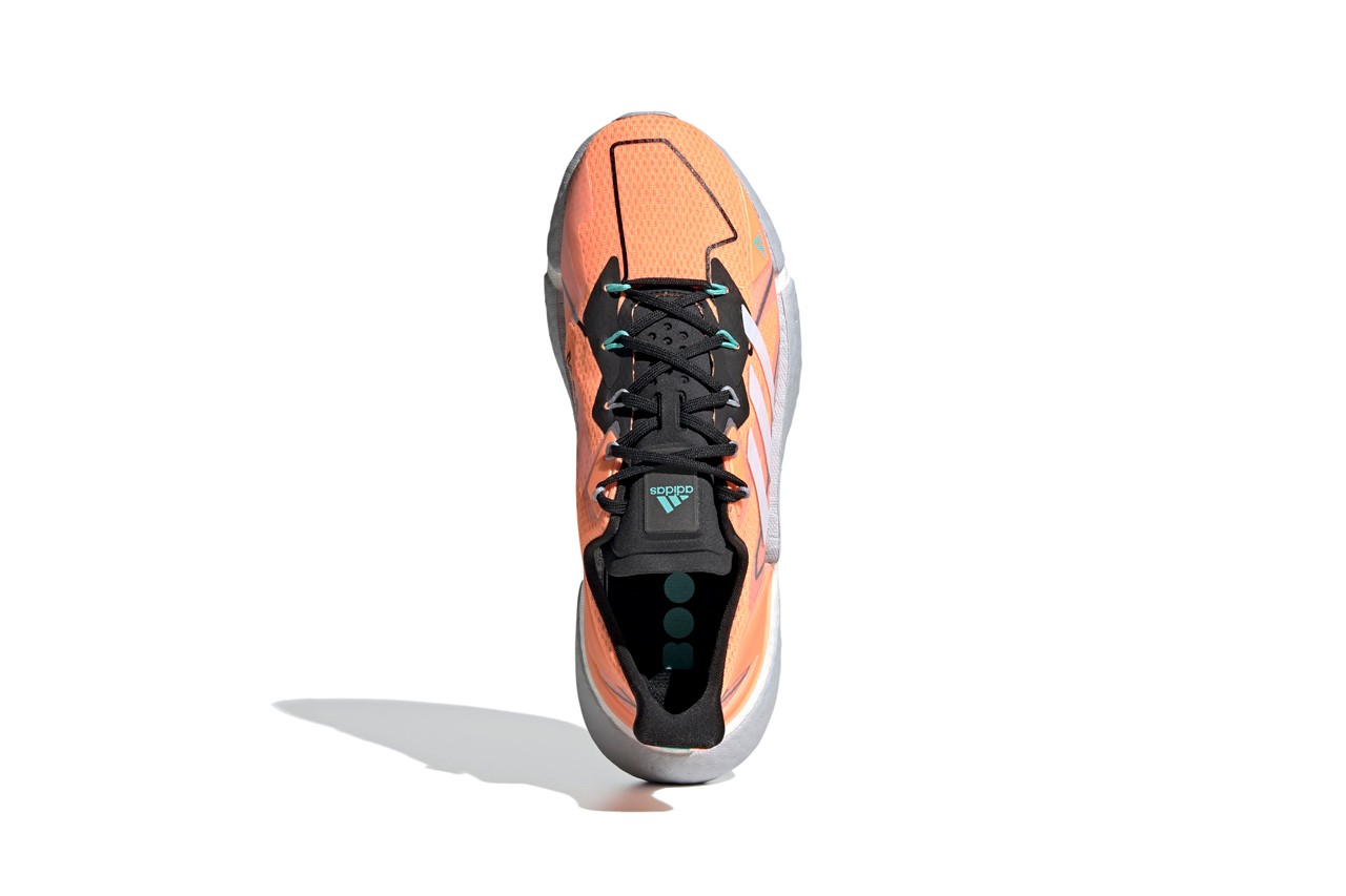 Bird's eye view of orange sneaker with black down the middle