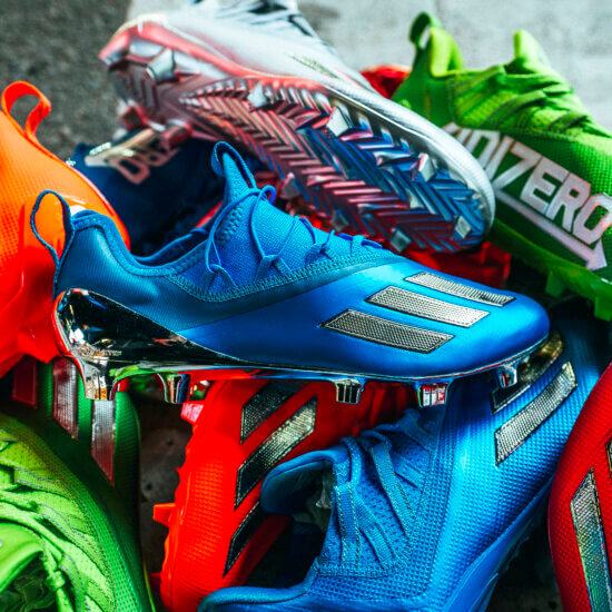 Blue, silver and orange cleats stacked on top of each other