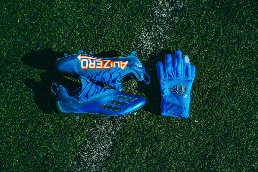 Blue cleats with blue hand gloves
