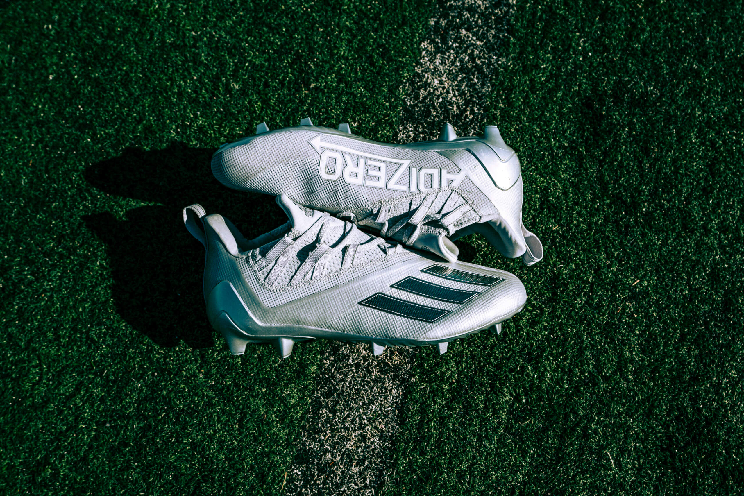 Silver cleats facing each other