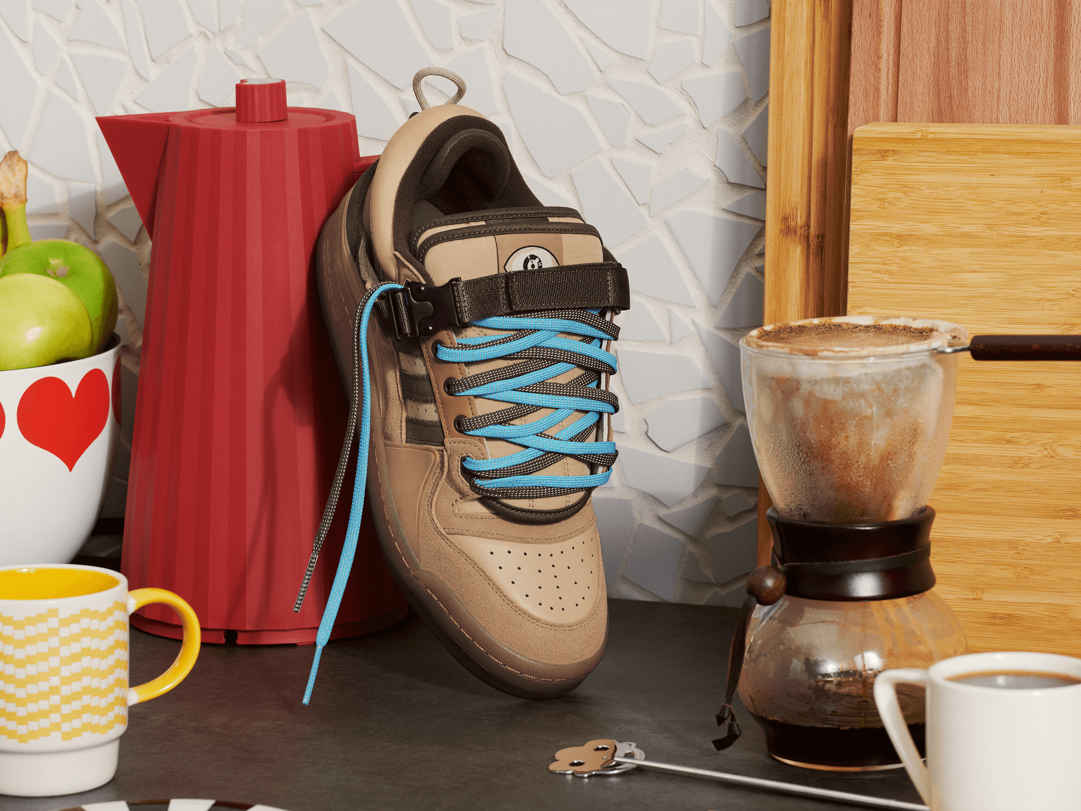 Brown sneaker with blue laces