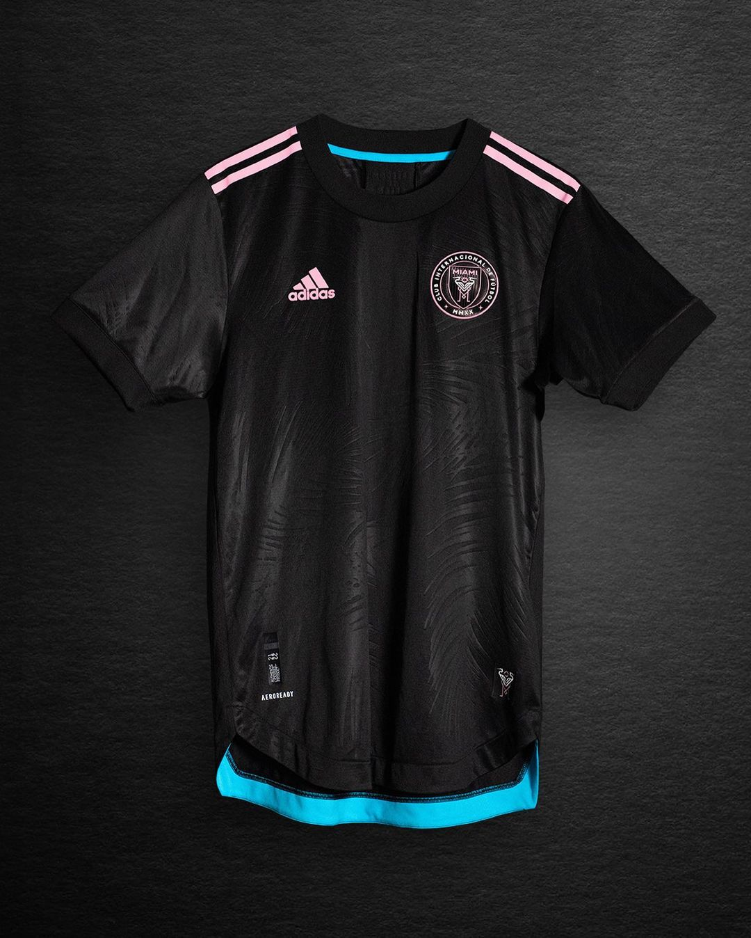 Black jersey with pink stripes on the jersey and light blue hem at the bottom