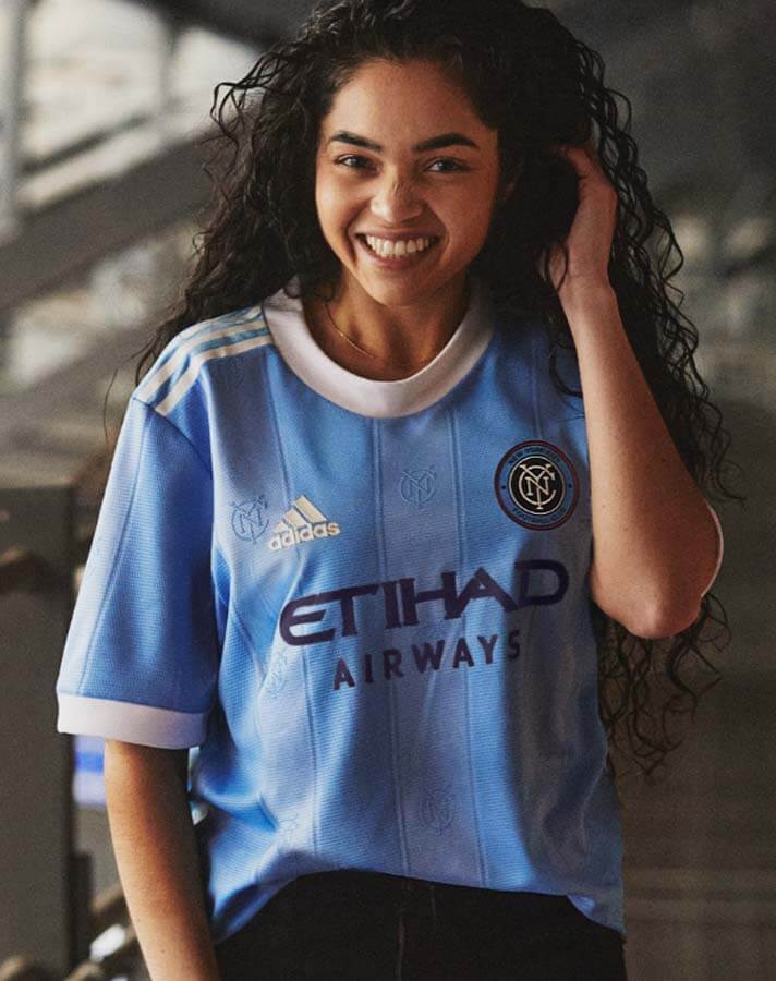 Light blue jersey with woman wearing her hair down