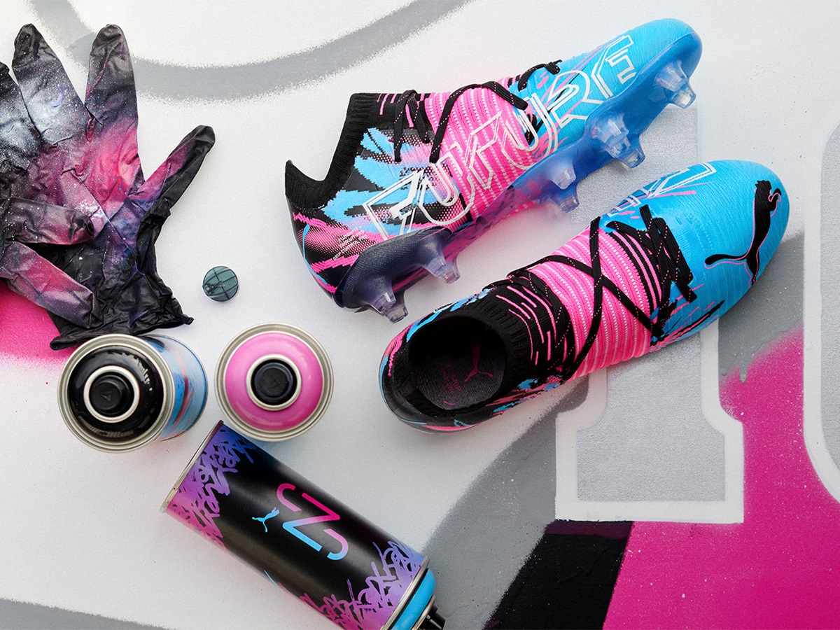Colorful football boots with matching gloves and water bottle