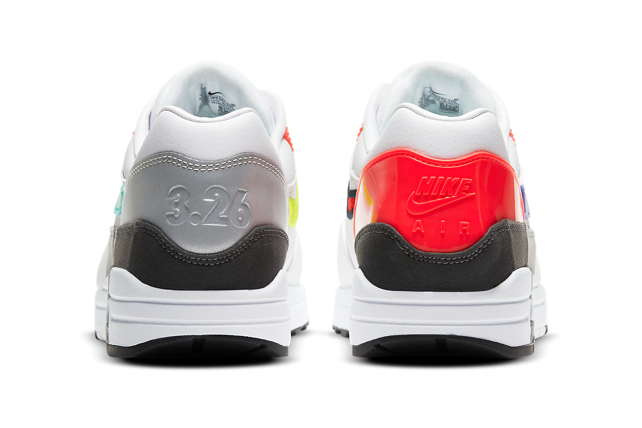 Two sneakers with one heel gray and the other orange