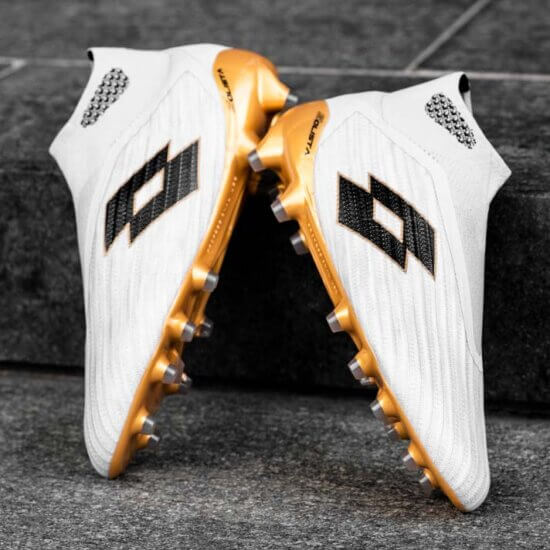 White football boot with gold sole