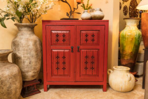 Red wormwood dresser with carved details at furniture store in Cabo San Lucas, Mexico