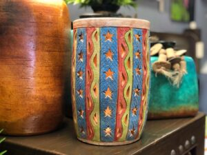 Multicolor vase with hand carved details