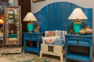 Blue curved bed frame and nightstands, made in Mexico