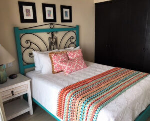Turquoise bed frame with wrought iron details