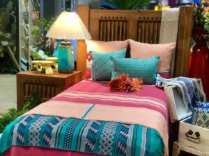 Twin bed frame, colorful bedding and pillows made in Mexico