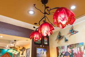 Red wrought iron chandelier with red blown glass in Cabo San Lucas