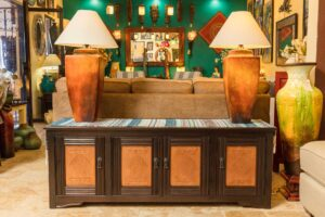 Dark wormwood bed table with copper details