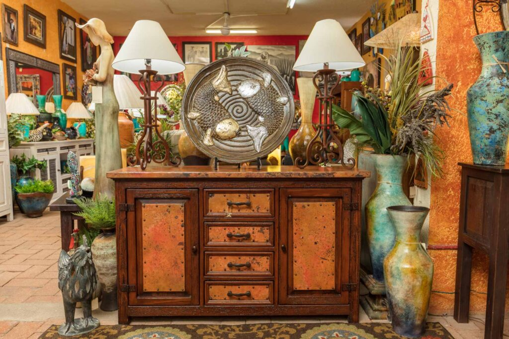 Wooden buffet with copper details at furniture store in Cabo San Lucas, Mexico