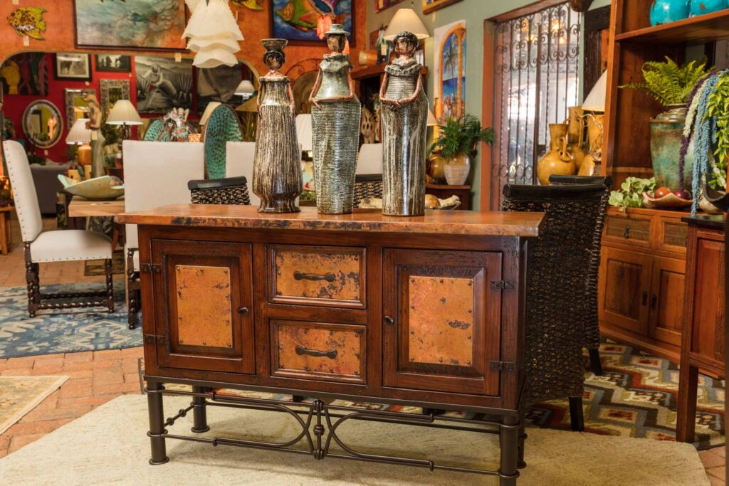 Console table with hammered copper details and wrought iron base