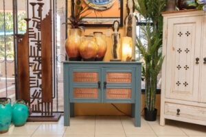 Small blue console table with two doors and copper details