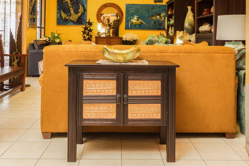 Small two door console table with copper details
