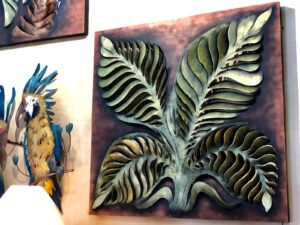 Large metal wall art of a plant with four leaves