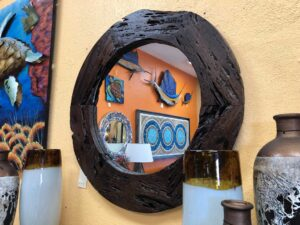 Round mirror with dark wood frame, for sale in Cabo San Lucas