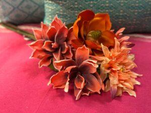 Bright orange faux flowers