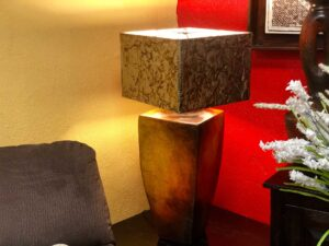 Cubed ceramic table lamp with aluminum-detailed lampshade