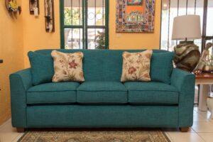 Turquoise La-Z-Boy Dixie queen sofa sleeper in Cabo San Lucas showroom