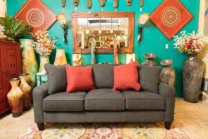 Dark gray La-Z-Boy talbot sofa in Cabo San Lucas with red throw pillows