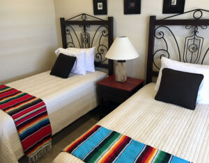 Black twin bed frames with iron details, made in Mexico and sold in Cabo San Lucas