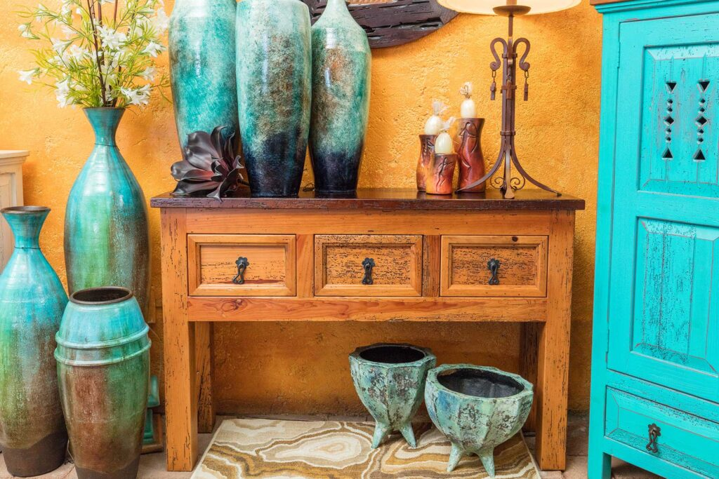 Wormwood console table with three small drawers, sold at furniture store in Cabo San Lucas