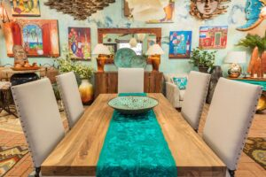 Large rectangular perota dining table with upholstered chairs