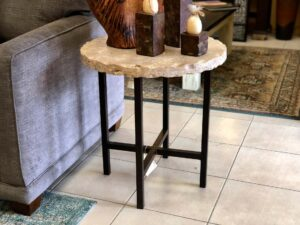 Round end table with stone top and iron base