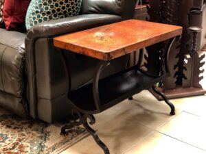 Hammered copper end table with iron base