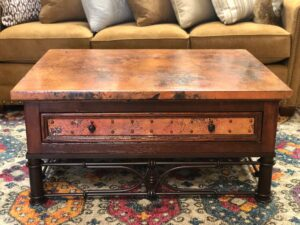 Coffee table with hammered copper and iron base