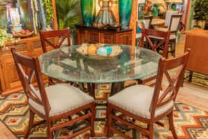 Round crackled glass dining room table with modern chairs, sold in Cabo San Lucas