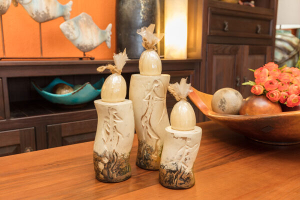 Ceramic candle holders with cave painting carvings