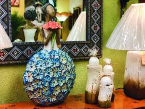 Ceramic sculpture decor of woman wearing flower dress