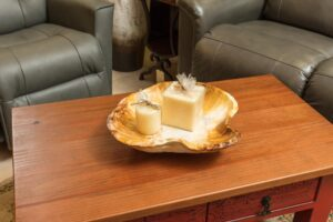 Decorative plate on coffee table, sold at furniture store in Cabo San Lucas