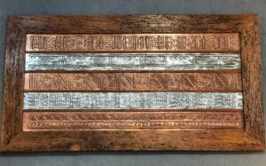 Hammered copper and aluminum wall art with wooden frame