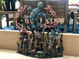 Metal art work of aquatic environment