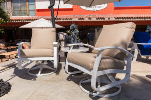 Two swivel rocking chairs from Telescope's outdoor furniture collection, available at Casa Bonita in Cabo San Lucas