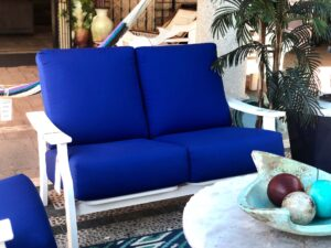 Telescope outdoor loveseat with blue cushions