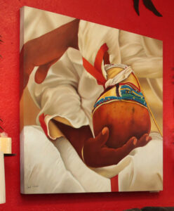 Closeup painting of a man holding a peyote
